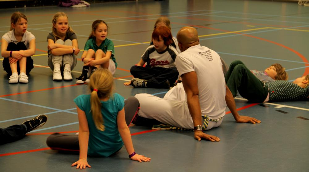 Slide 2: Workshop Capoeira